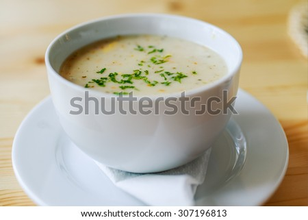 Garlic soup on a wooden table in a restaurant.