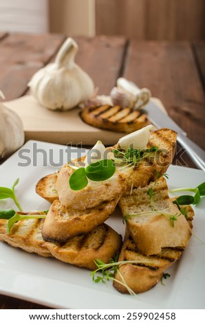 Garlic toast toasted panini sprinkled in microgreens, everything pure organic, eat clean