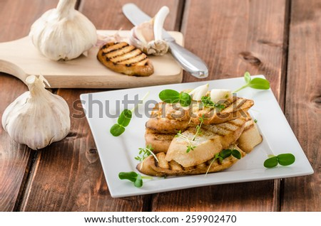 Garlic toast toasted panini sprinkled in microgreens, everything pure organic, eat clean - stock photo
