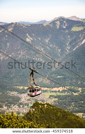 GARMISCH, GERMANY - JULY 10: Cable car at the Osterfeldkopf mountain in Garmisch, Germany on July 10, 2016. The Alpspitzbahn cableway goes up to 2033 meters. - stock photo