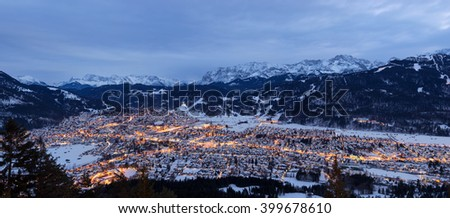 Garmisch-Partenkirchen in winter with fog and mountains in the background at sunset, Bavaria, Germany - stock photo