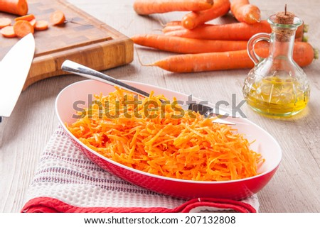 garnish with chopped carrots and oil - stock photo