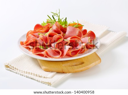 garnished plate with ham and spring onion