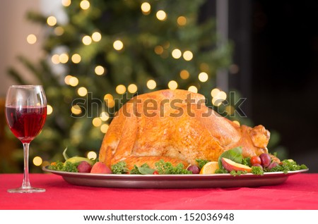 Garnished roasted turkey on holiday with red wine - stock photo