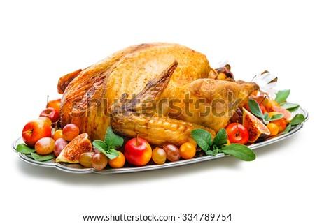 Garnished roasted turkey on platter over white background - stock photo