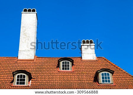 Garret roof with window and chimney, Riga, Latvia - stock photo
