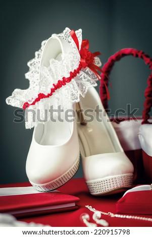 Garter on wedding shoes. Focused on garter - stock photo