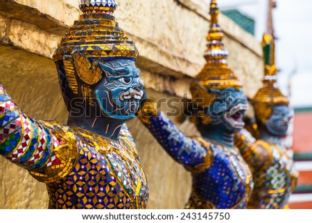 Garuda statues in the Grand Palace. Temple of the Emerald Buddha. Gold ornamental patter statuettes.Wat Phra Kaew Bangkok,Thailand.