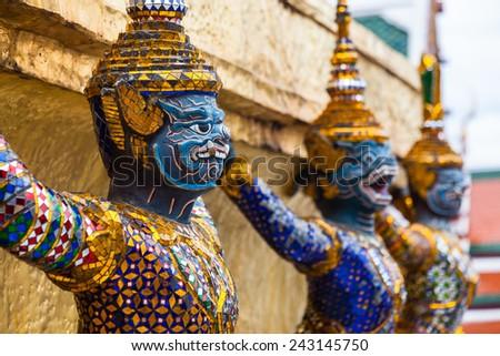 Garuda statues in the Grand Palace. Temple of the Emerald Buddha. Gold ornamental patter statuettes.Wat Phra Kaew Bangkok,Thailand. - stock photo