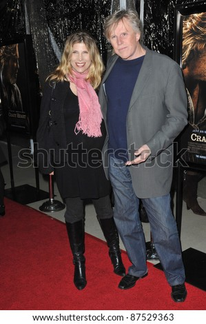 "Gary Busey & wife at the Los Angeles premiere of ""Crazy Heart"" at the Academy of Motion Picture Arts & Sciences in Beverly Hills. December 8, 2009  Los Angeles, CA Picture: Paul Smith / Featureflash"