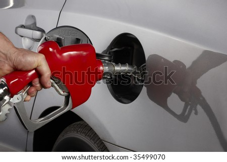 Gas attendant fills car with gasoline