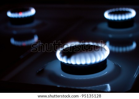 Gas burner in the kitchen oven - stock photo