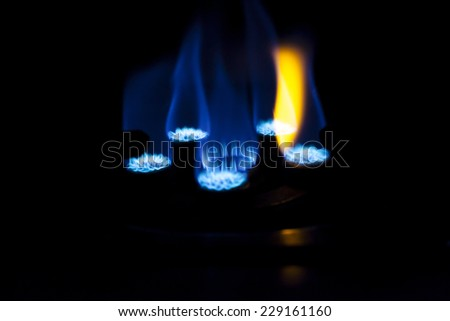 Gas burner on stove. - stock photo
