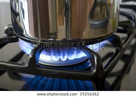 Gas burner with a pot - stock photo