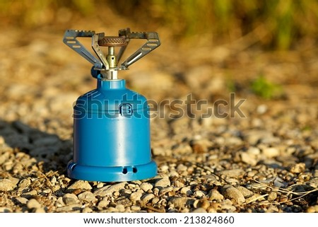 Gas camping stove in the nature background - stock photo