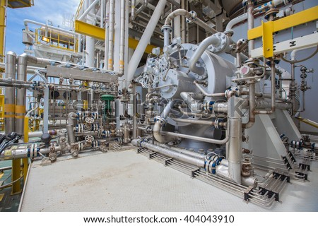 gas compressor for boost up gas pressure in process at oil and gas processing platform - stock photo