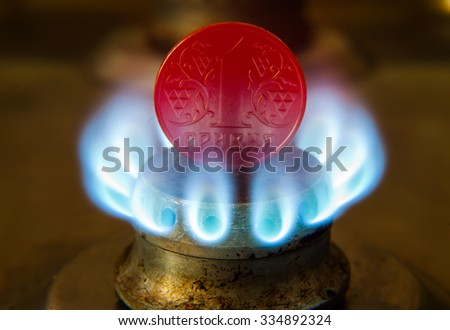 Gas cooker and money on a blue gas stove