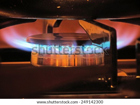 Gas cooker burning under a pot                                - stock photo