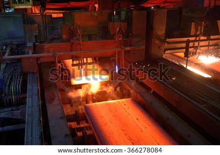 Gas cutting of the hot metal in a plant - stock photo