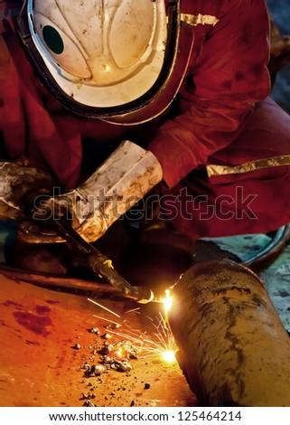 Gas cutting steel pipe - stock photo