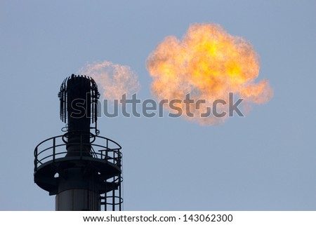 Gas flare at a refinery - stock photo
