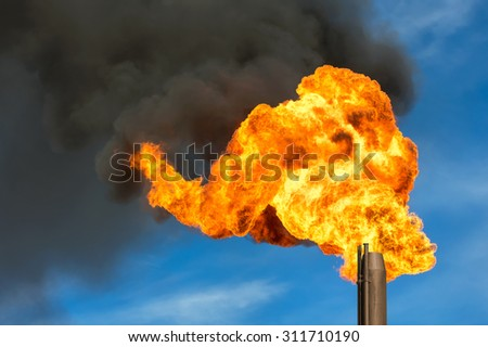 Gas flaring. Burning of associated gas at oil production. - stock photo