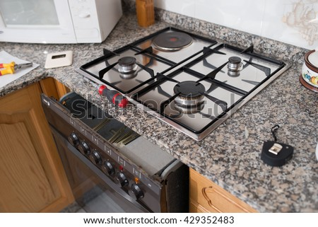 Gas hob and oven in a kitchen, Spain.