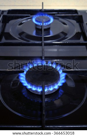 Gas hob burner rings on an oven top. - stock photo