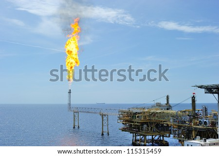 Gas is releasing and burning to the atmosphere at an offshore gas platform