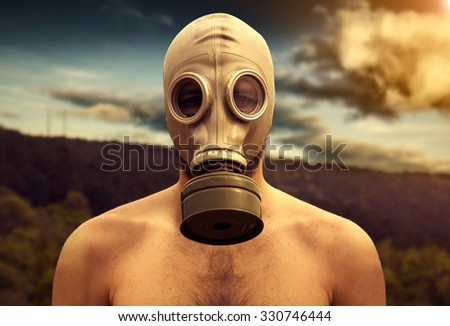 gas mask man with darksky - stock photo