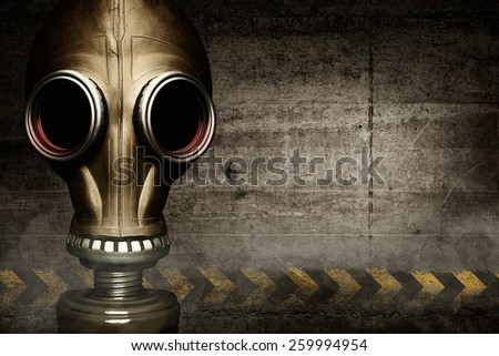 Gas mask shrouded in smoke on wall background - stock photo