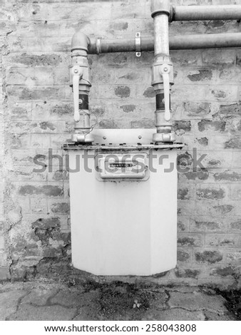 Gas meter flow meter to measure the volume of fuel gases in black and white - stock photo