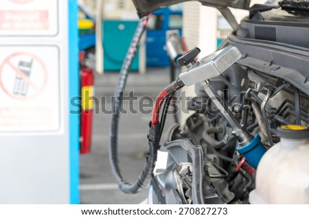 Gas nozzle to add gas in car at gas station