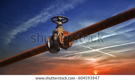 Gas/oil old rusty pipe line against sky sunset background