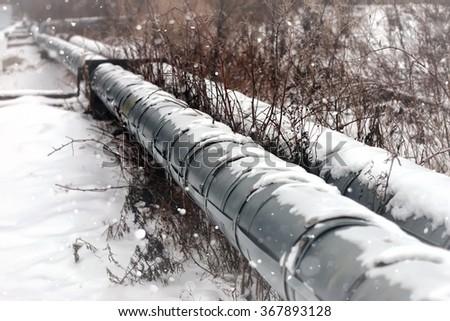 gas pipe transite snow winter - stock photo