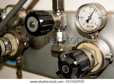 Gas Pipes with Valves and Instrument - stock photo