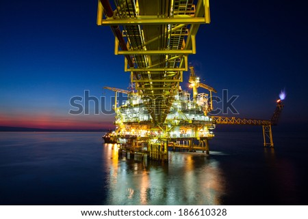 Gas platform or rig platform in sunset or sunrise time. - stock photo