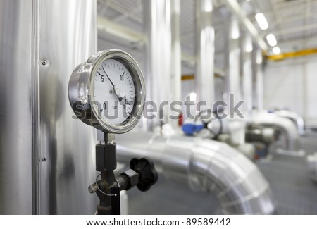 Gas power station. New pipes covered with insulation. - stock photo