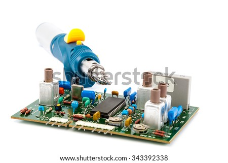 Gas Powered Soldering and electronic board isolated on a white background. - stock photo