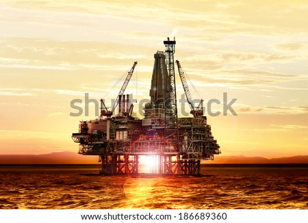 gas production on the sea at sunrise, platform - stock photo