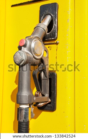 Gas pump nozzle retro. - stock photo