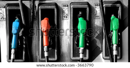 Gas pump nozzles photoshop edited - stock photo