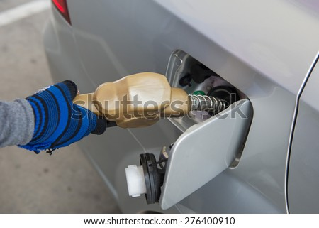Gas pump service - stock photo
