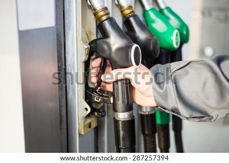 Gas station attendant at work - stock photo
