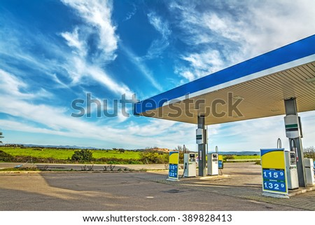 gas station under a cloudy sky in Italy