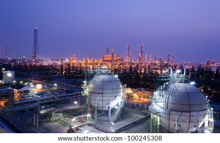Gas storage spheres tank in petrochemical plant at night - stock photo