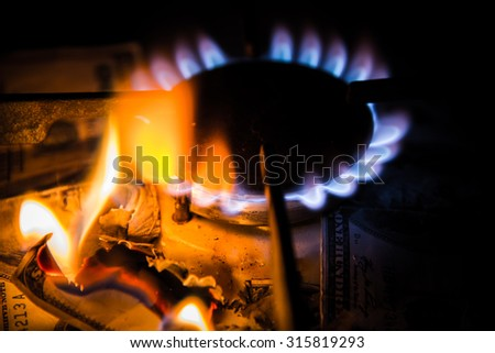 Gas stove. Dollars on a gas cooker