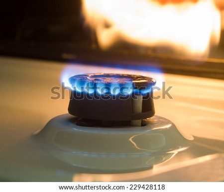 gas stove with flame in darkness