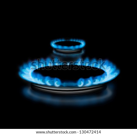 Gas stove with flames over it - on black background - stock photo
