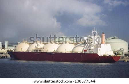 Gas tanker loading in port, Japan - stock photo